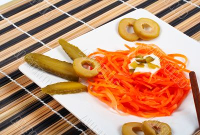 Salad of carrot on a porcelain plate