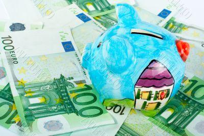Piggy bank on euro money