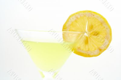 Detail of green cocktail with lemon