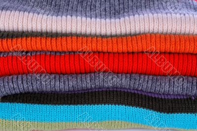 Several colors pullovers stack
