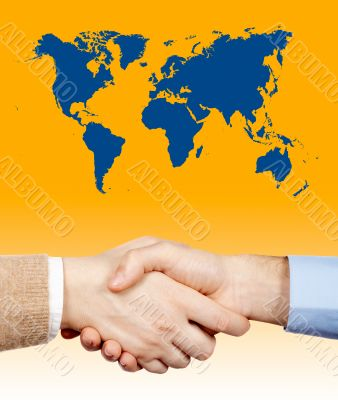 Business handshake under the world