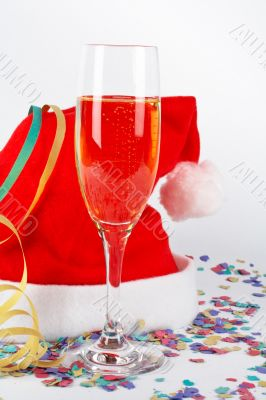 Champagne glass and christmas hat