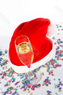 Champagne glass and christmas hat with ribbons