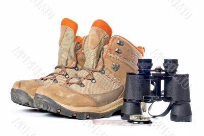 Hiking boots, compass and binoculars