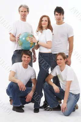 five people with a globe