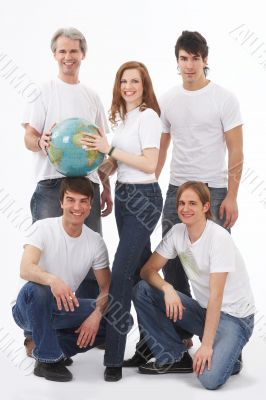 five young people with a globe