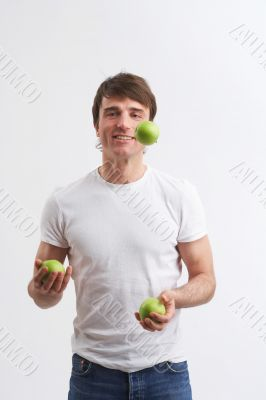 juggling green apples