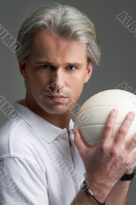 portrait of sporty man, the ball and his hands