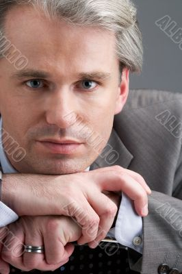 portrait of a businessman with his hands