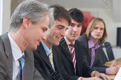 four men at work