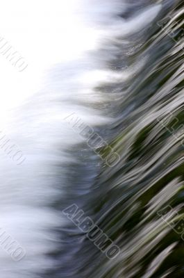 Rushing water over weir