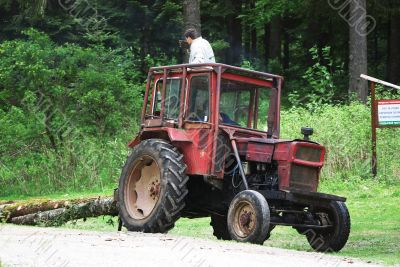 Tractor dragging lumber