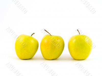 Three yellow apples