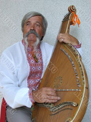 Senior ukrainian folk Kobzar with bandura