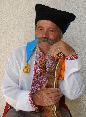 Senior ukrainian folk Kobzar with bandura