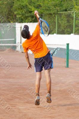 tennis. boy is serving