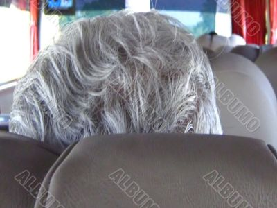 traveler pensioner white hair closeup