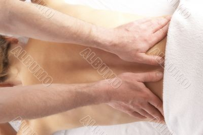 gentle massage of the lower back