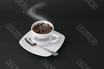 steaming coffee cup with writing