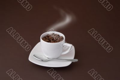 steaming coffee cup with beans