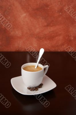 steaming cappuccino with coffee beans