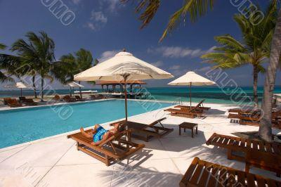 relaxing at tropical pool