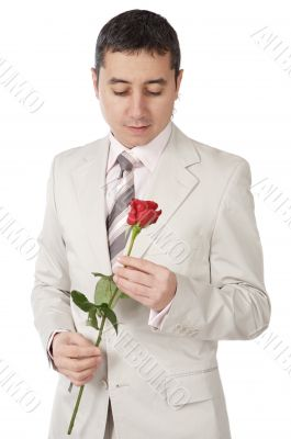 young person enamored with a rose