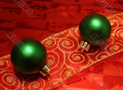 Two Green Balls on a Ribbon