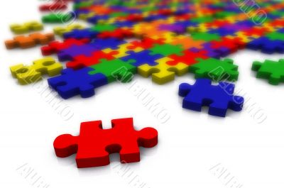 colour puzzle - only red piece in focus