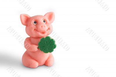 Talisman pig with shamrock