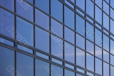 reflecting glass facade of a skyscraper