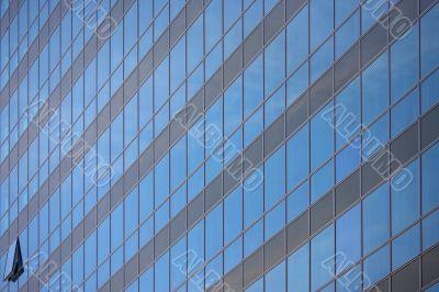 single open window on glass facade