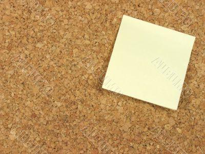 Blank note on corkboard