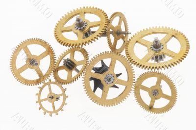 eight old gold-coloured little cogwheels