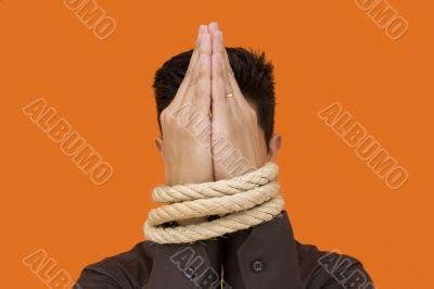 Captive men praying