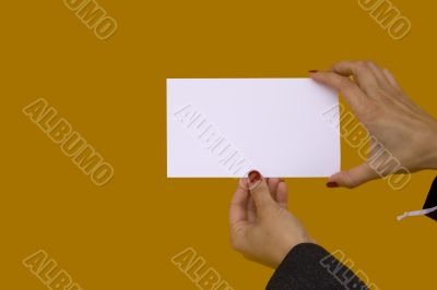 Hands showing a blank card