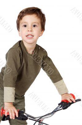 adorable boy cycling