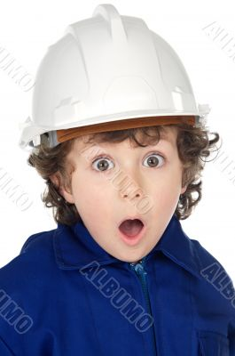 Adorable boy worker with surprise gesture