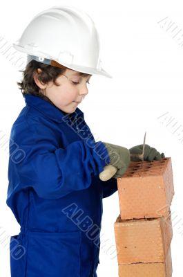 adorable future builder constructing a brick wall