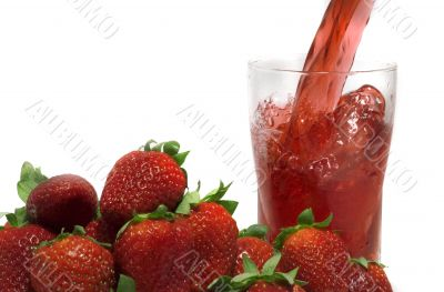 pouring fresh strawberry  juice
