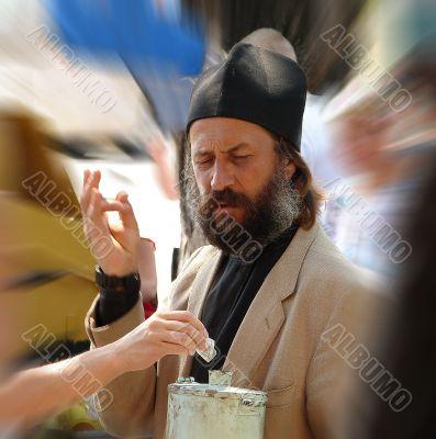 Russian orthodox monk gathering donation