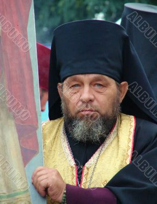 Ukranian Orthodox monk with banner