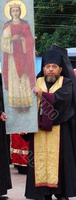 Ukranian Orthodox monk with banner