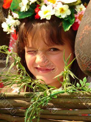 Cozy ukrainian baby girl with garland