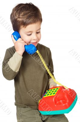 adorable boy speaking on the telephone