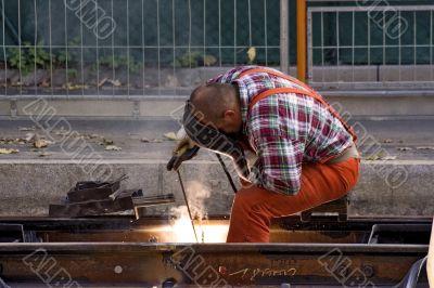 Construction Worker Fixing Rails
