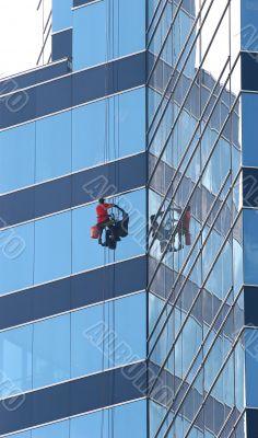 Window Washer on Blue Glass