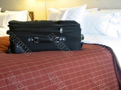 luggage in hotel room