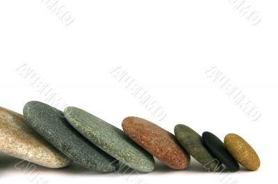 Seven pebbles line