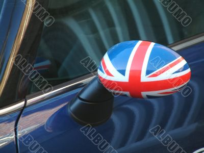 british car wing mirror with flag